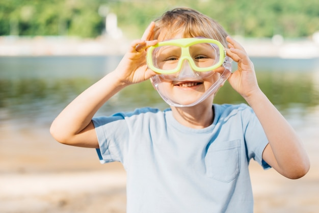 Playful boy with goggles Free Photo