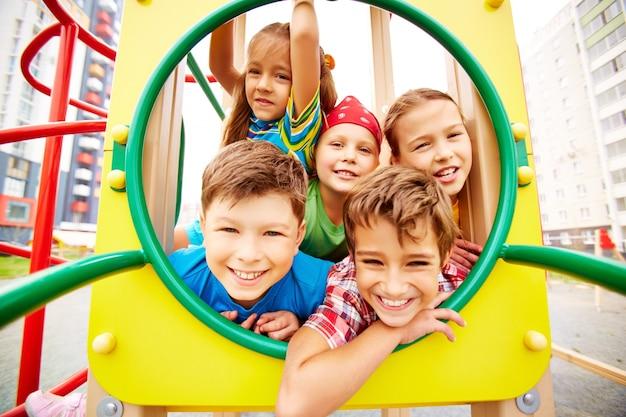Playful classmates having fun on playground Free Photo