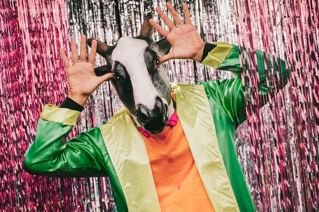 Playful cow costumated male for carnival party Free Photo