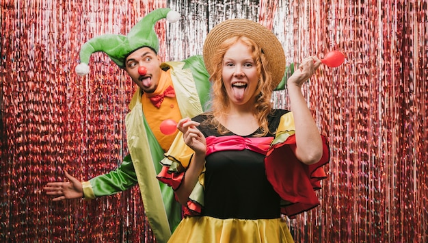 Playful friends disguised at carnival party Free Photo