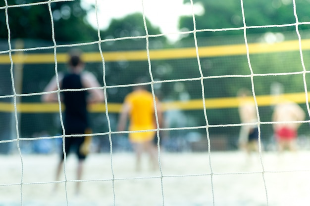 Playground for beach volleyball in summer. sports net on a playground in the summer in sunlight Premium Photo
