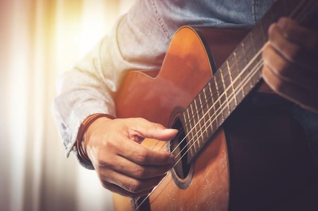 Playing classical guitar Premium Photo