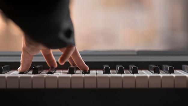 Playing digital piano concept Free Photo