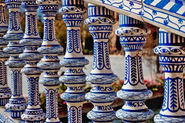 Plaza de espana of sevilla: beautiful railing painted in blue and white Premium Photo