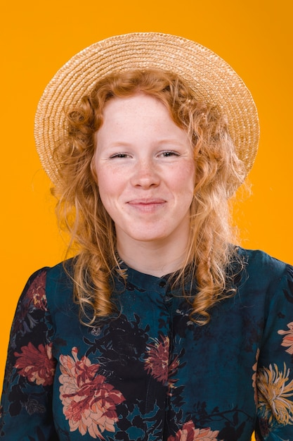75ab39114 Pleased curly redhead female in studio Photo | Free Download