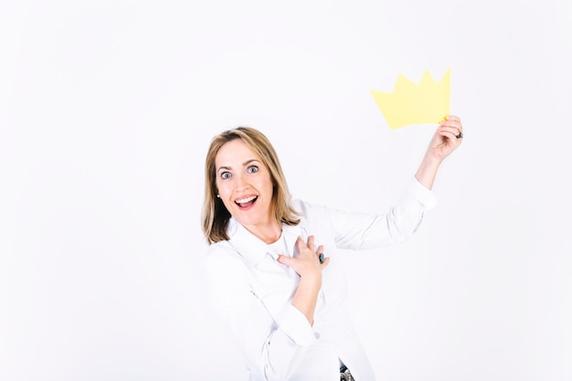 Pleased woman with paper crown Free Photo