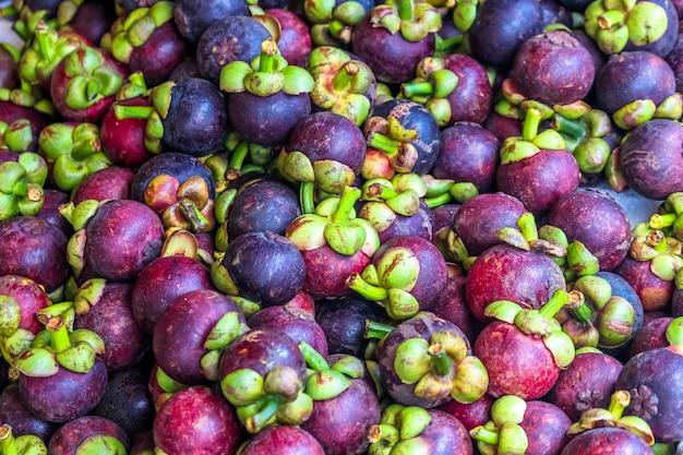 Plenty of queen of fruit, mangoteen at fruit market Premium Photo