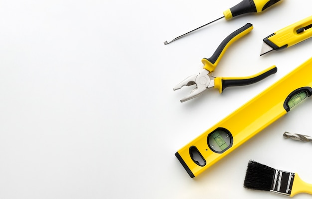 Pliers and rulers with copy space Free Photo