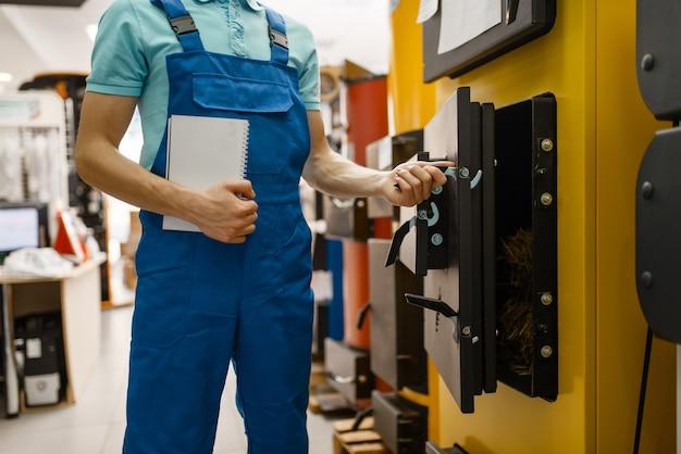 Plumber buying boiler with furnace, plumbering Premium Photo