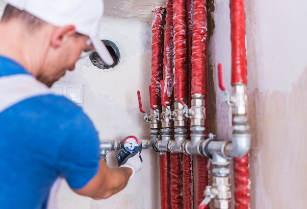 Plumber Checking on Water Supply Free Photo