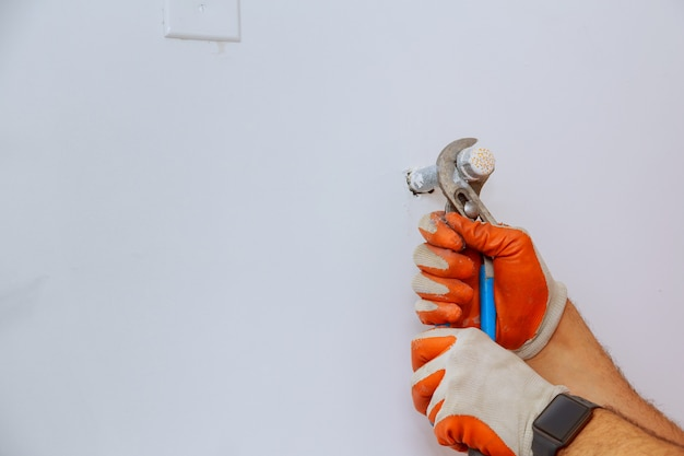 Plumber hands using wrench at work repair plumbing. Premium Photo