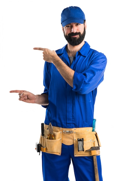 Plumber pointing to the lateral Free Photo