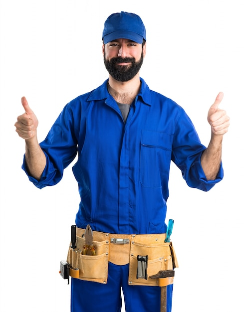 Plumber with thumb up Free Photo