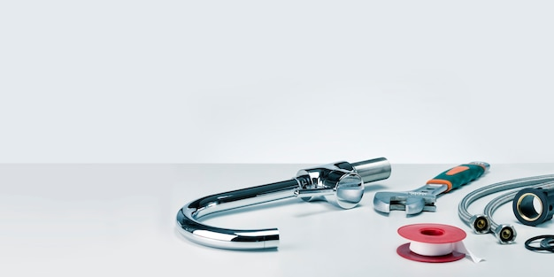 Plumbers tools and faucet banner with copy space. Premium Photo