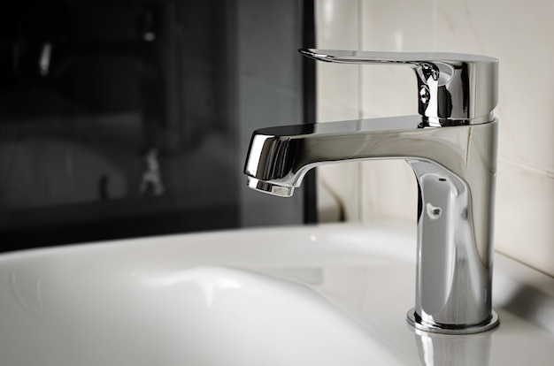 Plumbing concept. water tap, faucet in the bathroom. copy space Premium Photo