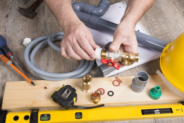 Plumbing do-it-yourself with different tools Premium Photo