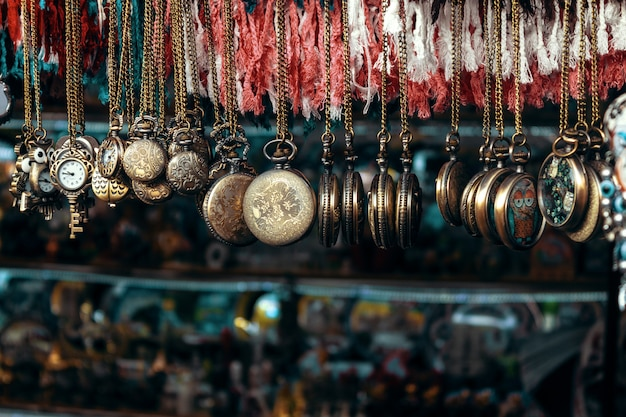 Pocket watch on chain hangs in souvenir shop Premium Photo