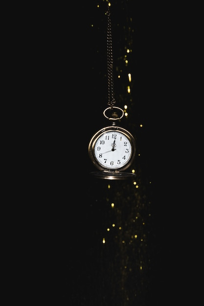 Pocket watch with glitters Free Photo