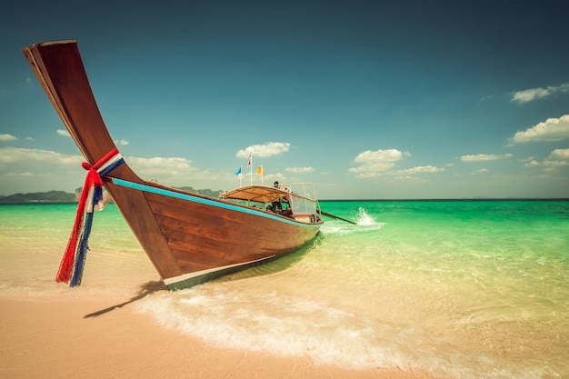 Poda island beach and long tail boats at krabi in thailand Premium Photo