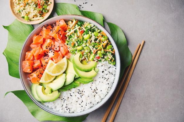 Poke bowl with salmon served in bowl Premium Photo
