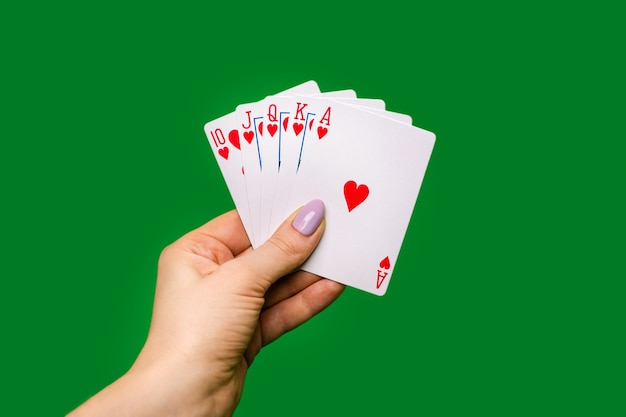 Poker cards on green background Premium Photo