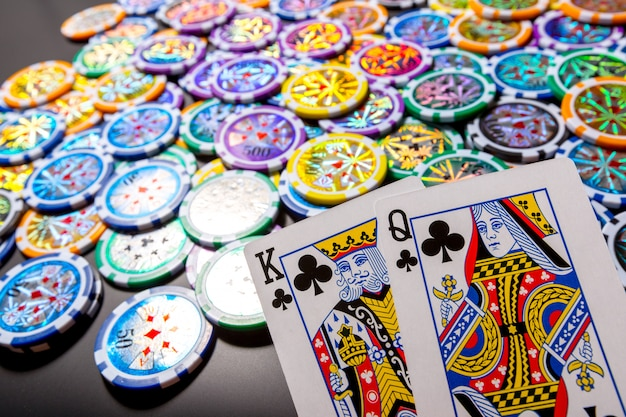 Poker chips and cards on black Premium Photo