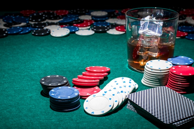 Incredible Poker Chips And Glass Of Whiskey On Green Poker Table Photo Home Remodeling Inspirations Basidirectenergyitoicom