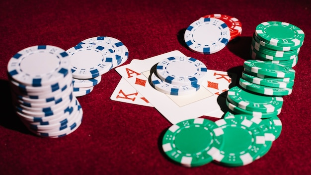 Poker chips and playing cards on table Free Photo