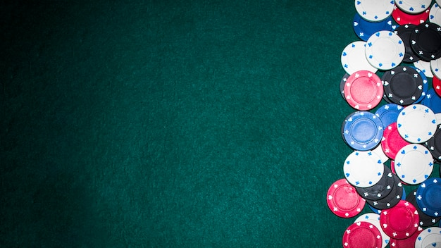 Poker chips on poker table with copy space for text Free Photo