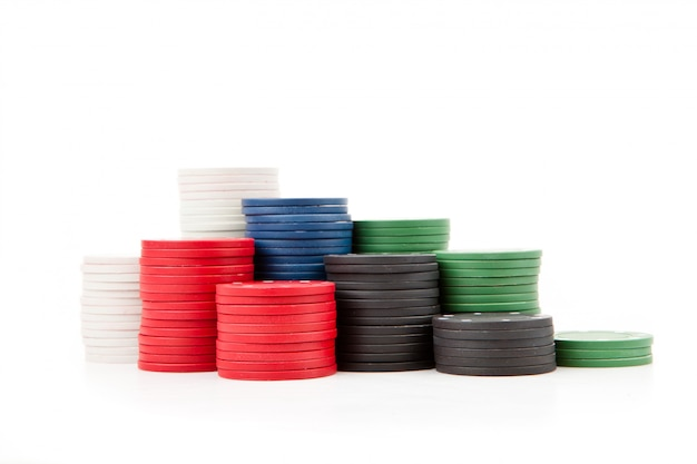 Poker coins piled up together against a white background Premium Photo