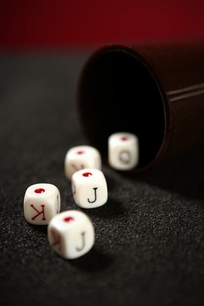 Poker game dices over black table Premium Photo