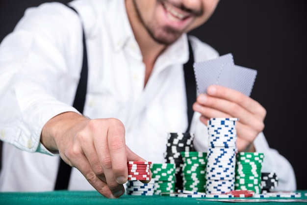 Poker player with poker chips. Premium Photo