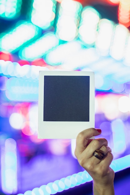 Polaroid photo on the background of glowing lamps Free Photo