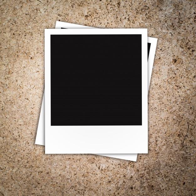 Polaroid photo frame on wood background Premium Photo