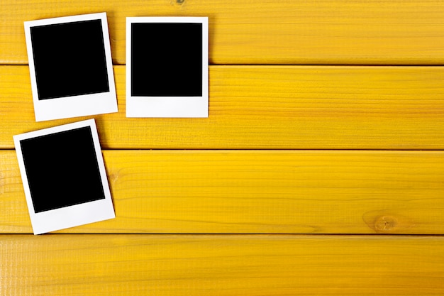 polaroid po prints on a wood desk or table po | free download