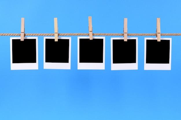 Polaroid photos on a blue background Free Photo