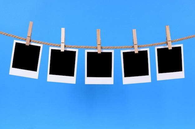 Polaroid photos on a string Free Photo