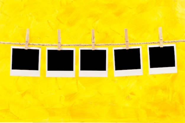 Polaroid photos on a yellow background Free Photo