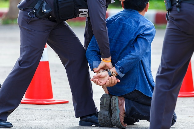 Police helped to catch the guilty and lock the handcuffs Premium Photo