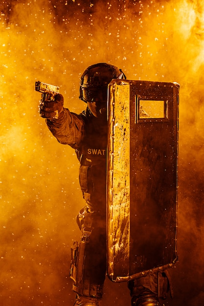 Police officer with ballistic shield Premium Photo