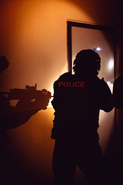 A police unit detains the perpetrator of a crime hidden in a building Premium Photo