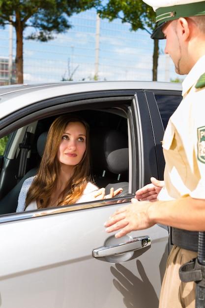 Police - woman in traffic violation getting ticket Premium Photo