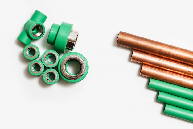 Polypropylene and copper pipes fittings and cutter Premium Photo