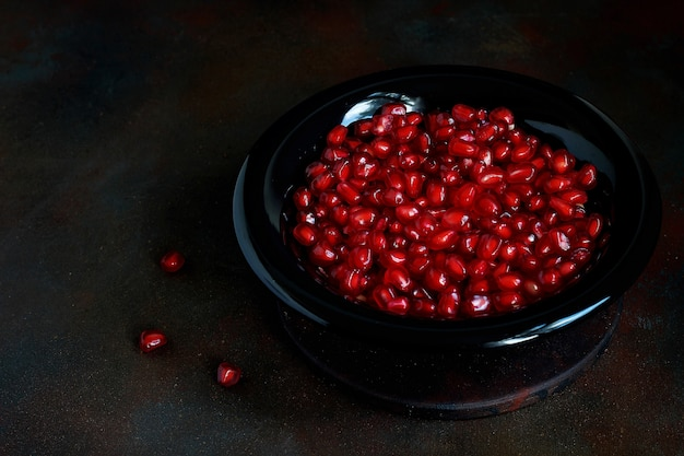 Pomegranate seeds in a bowl Free Photo