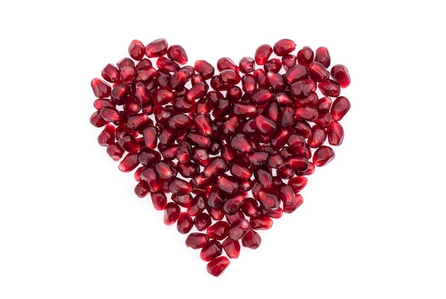 Pomegranate seeds isolated on white. Premium Photo