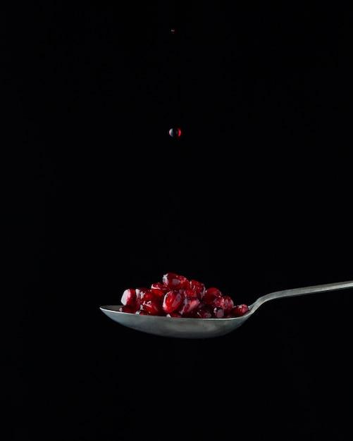 Pomegranate on spoon Free Photo