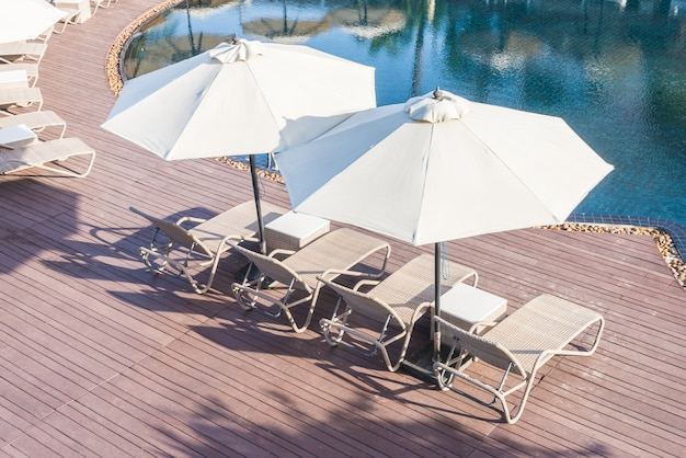 Pool chair with umbrella Free Photo