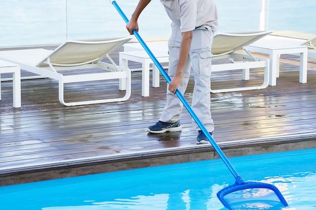 Pool cleaner during his work. Premium Photo