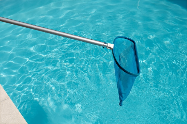 Pool skimmer on bright water surface in swimming pool Premium Photo