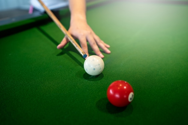 Pool table he play a snooker white ball to red ball on the
